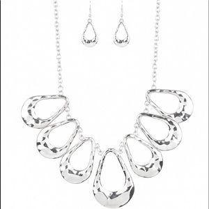 Silver necklace and earrings set.